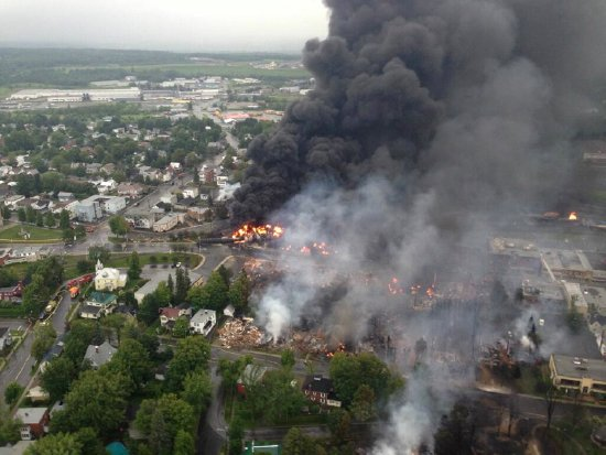 Bakken Crude oil train derailment in Lac Magantic Quebec, 2013. Photo by Sûreté du Québec via Wikimedia Commons