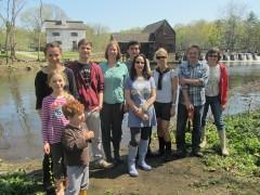 Members of the Pocantico sampling team meet below the dam at Philipsburg Manor in Sleepy Hollow