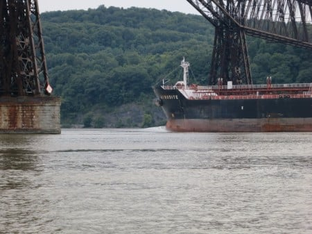 The crude oil tanker Afrodite passes under Walkway Over the Hudson, near the drinking water intakes for the City of Poughkeepsie and the Town of Lloyd.