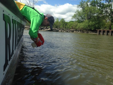 Carol Knudson of Lamont-Doherty Earth Observatory grabs a water sample at the public boat launch in the City of Newburgh.