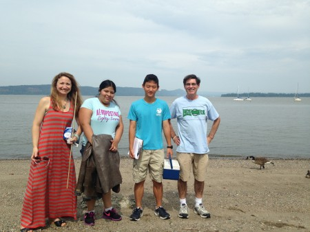 Ossining High School teachers Bridget Baumann (left) and Artie Carlucci (right), a longtime Riverkeeper member, with their students at Ossining's Hudson River beach. Photo by Dan Shapley/Riverkeeper