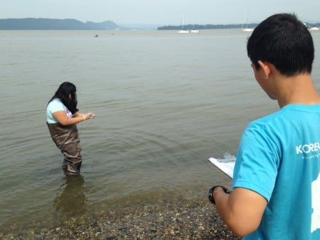 Students take a water sample from the beach at Louis Engel Park in Ossining. Photo by Dan Shapley/Riverkeeper.