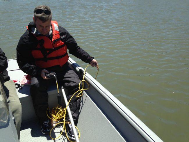 Dr. Greg O'Mullan measures oxygen in Westchester Creek. (Photo by Dan Shapley / Riverkeeper)
