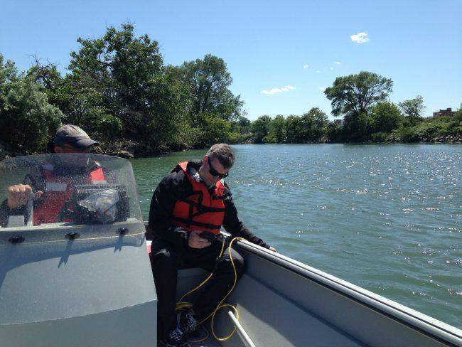 Greg takes an oxygen sample in Steinway Creek. (Photo by Dan Shapley / Riverkeeper)