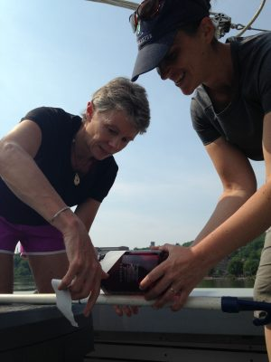 "Carol Knudson of Lamont-Doherty Earth Observatory and Jennifer Epstein of Riverkeeper rig a bottle to a pole for sampling associated with ""micropollutant"" analysis by Cornell researchers. (Photo: Dan Shapley)"