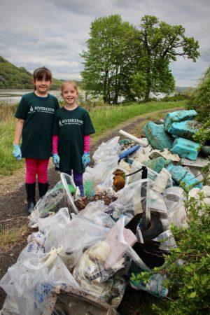 Children pick up trash at Riverkeeper Sweep 2019 at Iona Island.